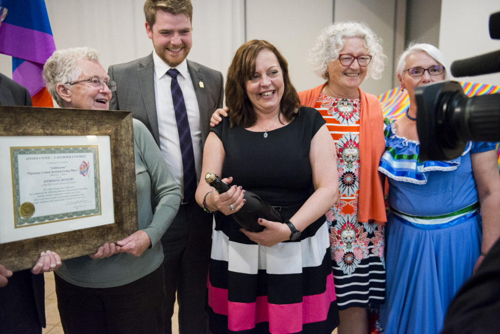 Staff and supporters celebrate The Ashbourne becoming Canada's first Affirming assisted living in spring 2017-- and make it on to video themselves. Photo: Admire Studios.