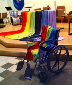 Anne Squire's rainbow cape draped over her wheelchair; Emmanuel United Church's Affirming celebration, 27 May 2017. Anne had died on April 24.